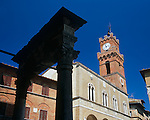 Tuscany, Italy<br /> Clock tower and silhouetted well on the Piazza Pio II - Pienza's main piazza