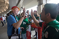 MOSCOW, RUSSIA - June 17, 2018: A Germany fan hi-fives Mexico fans before their 2018 FIFA World Cup group stage match at Luzhniki Stadium.