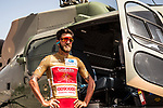 Gold Jersey wearer Loic Chetout (FRA) Cofidis poses beside a helicopter before the start of Stage 4 of the 2018 Tour of Oman running 117.5km from Yiti (Al Sifah) to Ministry of Tourism. 16th February 2018.<br /> Picture: ASO/Muscat Municipality/Kare Dehlie Thorstad | Cyclefile<br /> <br /> <br /> All photos usage must carry mandatory copyright credit (&copy; Cyclefile | ASO/Muscat Municipality/Kare Dehlie Thorstad)