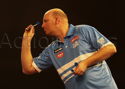 29.12.2015. Alexandra Palace, London, England. William Hill PDC World Darts Championship. Vincent van der Voort throws in the first leg