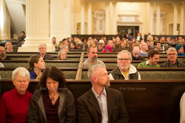 People gather in the Arlington Street Church near Boston Common in Boston, Mass., on April 16, 2013, the day after bombings at the Boston Marathon.