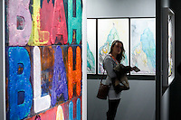 New York City, NY. 06 November 2014. A woman observes an artwork during the IFPDA Print Fair, at the Park Avenue Armory in new york