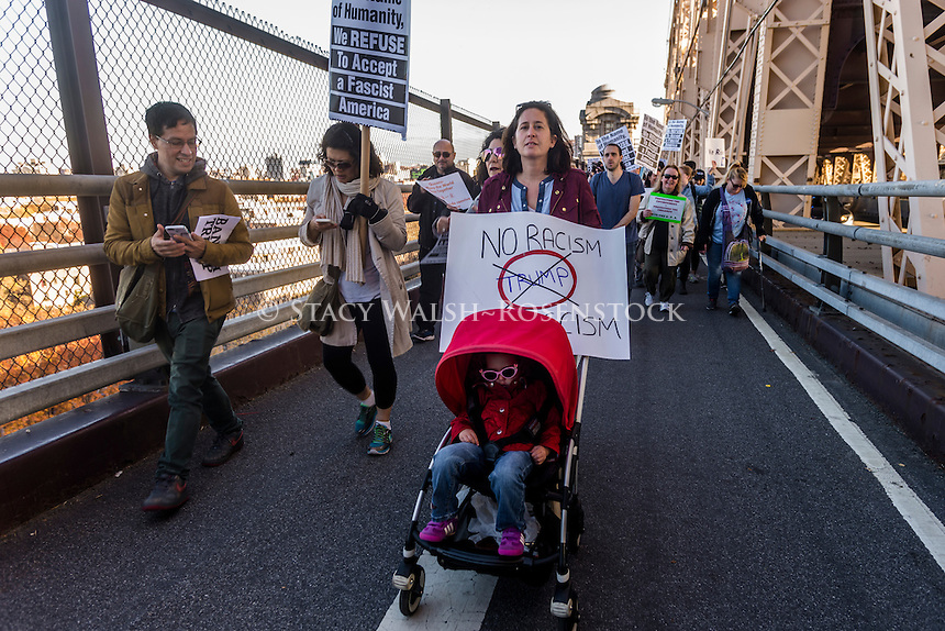 New York, USA - Anti Trump protesters from Queens, the most diverse borough in New York City and childhood home of Donald Trump, march across the Queensborough Bridge to protest outside Trump Tower. The march was organized by City Councilmember Jimmy van Bramer ©Stacy Walsh Rosenstock