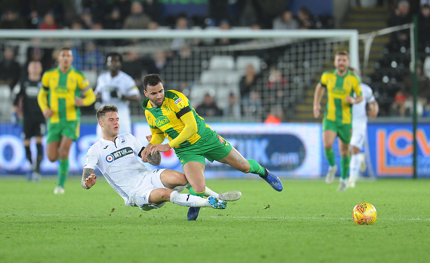 West Bromwich Albion's Hal Robson-Kanu is fouled by Swansea City's Joe Rodon<br /> <br /> Photographer Kevin Barnes/CameraSport<br /> <br /> The EFL Sky Bet Championship - Swansea City v West Bromwich Albion - Wednesday 28th November 2018 - Liberty Stadium - Swansea<br /> <br /> World Copyright © 2018 CameraSport. All rights reserved. 43 Linden Ave. Countesthorpe. Leicester. England. LE8 5PG - Tel: +44 (0) 116 277 4147 - admin@camerasport.com - www.camerasport.com