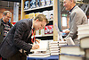 Labour Party Conference<br /> at Manchester Central, Manchester, Great Britain <br /> 24th September 2014 <br /> <br /> Owen Jones signing copies of his book at the Labour Party Conference <br /> The Establishment: And how they get away with it <br /> <br /> Photograph by Elliott Franks <br /> Image licensed to Elliott Franks Photography Services