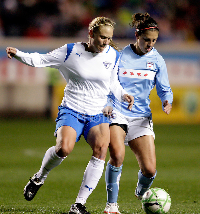 Boston Breakers midfielder Stacy Bishop (4) battles for the ball with Chicago Red Stars midfielder Carli Lloyd (10).  The Chicago Red Stars defeated the Boston Breakers 4-0 at Toyota Park in Bridgeview, IL on April 25, 2009.