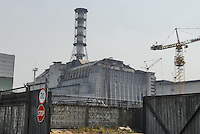 "- 20 years from the nuclear incident of Chernobyl, the reactor numbers 4, place of the catastrophe, covered by the ""sarcophagus"" in concrete built for contain the radiations....- 20 anni dall'incidente nucleare di Chernobyl, il reattore numero 4, luogo della catastrofe, coperto dal ""sarcofago"" in cemento costruito per contenere le radiazioni"