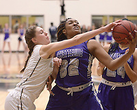NWA Democrat-Gazette/BEN GOFF @NWABENGOFF<br /> Maren Johnston (left) of Bentonville and Jasmine Franklin of Fayetteville go after a rebound on Friday Feb. 26, 2016 during the game in Bentonville's Tiger Arena.