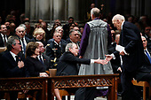 Former President George W. Bush shakes hands with Sen. Alan Simpson, R-Wyo, after he spoke during the State Funeral for former President George H.W. Bush at the National Cathedral, Wednesday, Dec. 5, 2018, in Washington. Watching are Jeb Bush and Laura Bush.<br /> Credit: Alex Brandon / Pool via CNP