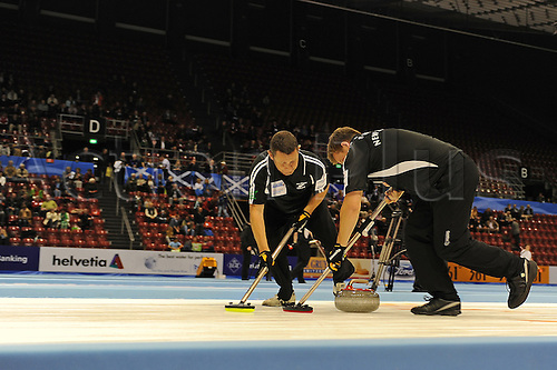 03.04.2012 Basel, Switzerland. New Zealand lead Kenny Thomson and second Scott Becker in action during day four of the Mens World Curling Championships from St Jakobshalle.