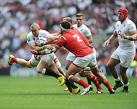 Mike Brown of England goes past Scott Baldwin of Wales during the Old Mutual Wealth Cup match between England and Wales at Twickenham Stadium on Sunday 29th May 2016 (Photo: Rob Munro/Stewart Communications)