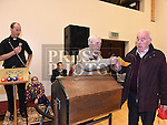 Peter Smith pulls the winning ticket for the car and hands it to Peace commissioner Peter Darcy at the Holy Family Christmas Draw. Photo:Colin Bell/pressphotos.ie