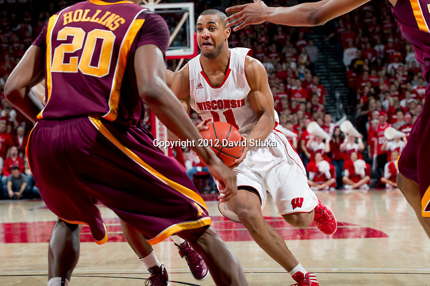 Wisconsin Badgers guard Jordan Taylor (11) handles the ball during a Big Ten Conference NCAA college basketball game against the Minnesota Golden Gophers on Tuesday, February 28, 2012 in Madison, Wisconsin. The Badgers won 52-45. (Photo by David Stluka)
