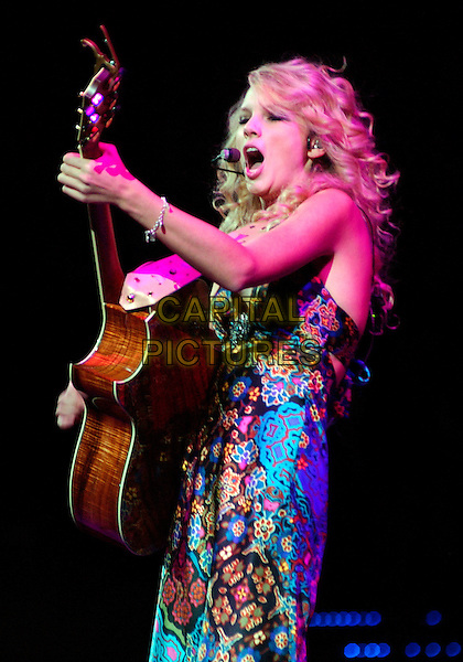 TAYLOR SWIFT.Country music entertainer TAYLOR SWIFT performs as opening act for George Strait's 2007 Tour held at the Mellon Arena, Pittsburgh, Pennsylvania, USA,.16 February 2007..half length guitar concert on stage .CAP/ADM/JN.©Jason L Nelson/AdMedia/Capital Pictures.
