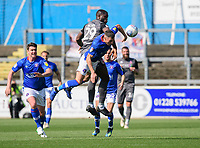 Lincoln City's John Akinde vies for possession with Carlisle United's Mike Jones<br /> <br /> Photographer Chris Vaughan/CameraSport<br /> <br /> The EFL Sky Bet League Two - Carlisle United v Lincoln City - Friday 19th April 2019 - Brunton Park - Carlisle<br /> <br /> World Copyright © 2019 CameraSport. All rights reserved. 43 Linden Ave. Countesthorpe. Leicester. England. LE8 5PG - Tel: +44 (0) 116 277 4147 - admin@camerasport.com - www.camerasport.com