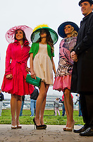 Models show off Derby hats on the backside during Dawn at the Downs at Churchill Downs as Kentucky Derby preparations continue on April 29, 2013.