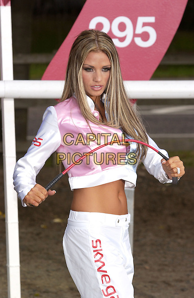JORDAN - KATIE PRICE.Sky Bet Launches 'The Horses' On Sky Channel 295, Hyde Park, Lancaster Gate, London, W1.August 25th, 2004.half length, pink and blue silk, satin jacket, belly, stomach, midriff, ring, jewellery, bending riding crop, gesture.www.capitalpictures.com.sales@capitalpictures.com.©Capital Pictures