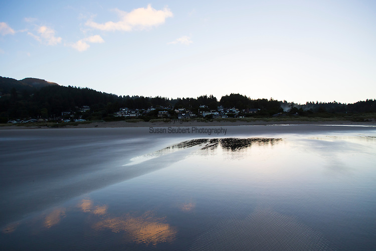 """Neahkahnie Beach in Manzanita, Oregon, a small beach town located in Tillamook County on the Northern Oregon coast.  Manzanita means """"little apple"""" in Spanish.  Neahkahnie Mountain is located at the north end of the 7 mile long beach."""