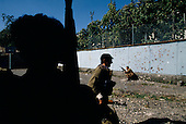 Sukhumi, Abkhazia<br /> September 27, 1993<br /> <br /> From behind a schoolhouse, advancing Abkhazian separatists prepare to attack Georgian forces that were held up inside the Parliament. Within hours the Abkhazians would control the Parliament building and the city.
