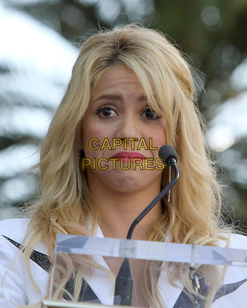 Shakira (Shakira Isabel Mebarak Ripoll).Shakira is Honored with the a Star on the Hollywood Walk Of Fame Held On Hollywood Blvd., Hollywood, California, USA..November 8th, 2011.headshot portrait white pink lipstick frowning funny.CAP/ADM/KB.©Kevan Brooks/AdMedia/Capital Pictures.