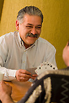 Happy hispanic man  playing cards, close-up