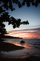 Sunset comes to Anini Beach on Kaua'i's North Shore.