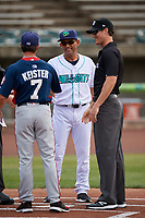 Lynchburg Hillcats manager Rouglas Odor (24) shakes hands with Tripp Keister (7) as umpire Mark Bass looks on during the lineup exchange before the first game of a doubleheader against the Potomac Nationals on June 9, 2018 at Calvin Falwell Field in Lynchburg, Virginia.  Lynchburg defeated Potomac 5-3.  (Mike Janes/Four Seam Images)