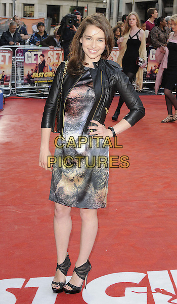 Emilia Clarke.The 'Fast Girls' UK film premiere, Odeon West End cinema, Leicester Square, London, England..June 7th, 2012.full length black leather jacket dress print grey gray hand on hip  .CAP/CAN.©Can Nguyen/Capital Pictures.