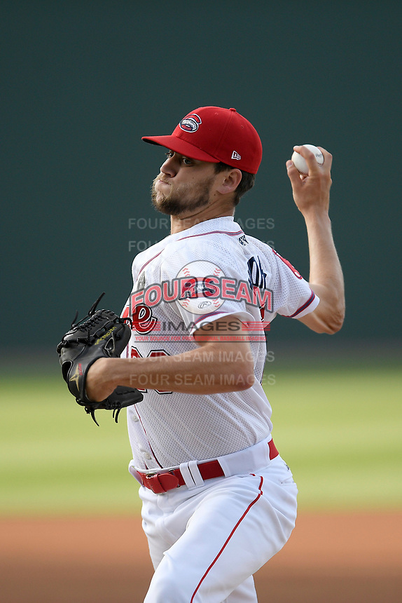 Starting pitcher Hunter Haworth (20) of the Greenville Drive delivers a pitch in a game against the Hickory Crawdads on Wednesday, May 15, 2019, at Fluor Field at the West End in Greenville, South Carolina. Greenville won, 6-5. (Tom Priddy/Four Seam Images)