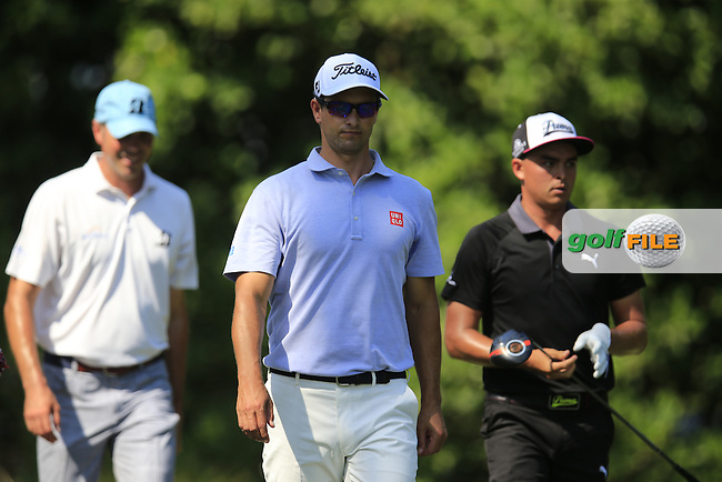 Matt Kucher (USA), Adam Scott (AUS) and Rickie Fowler (USA) during round 1of the Players, TPC Sawgrass, Championship Way, Ponte Vedra Beach, FL 32082, USA. 12/05/2016.<br /> Picture: Golffile | Fran Caffrey<br /> <br /> <br /> All photo usage must carry mandatory copyright credit (&copy; Golffile | Fran Caffrey)