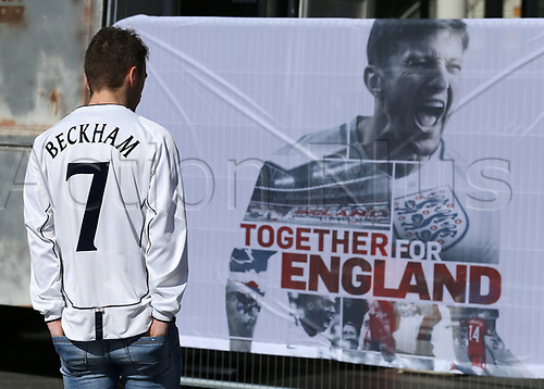 March 26th 2017, Wembley Stadium, London, England; World Cup 2018 Qualification football, England versus Lithuania; England fan wearing a David Beckham shirt looking at 'Together for England' banner outside Wembley Stadium