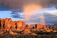Rain squall and rainbow in Arches National Park