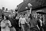 Bottle Kicking and Hare Pie Scrambling, Hallaton, Leicestershire, England 1973. Easter Monday.<br /> <br /> Men with Bottles, L-R David (Wacker) Wainright Michael Garfield, Stephen Hines