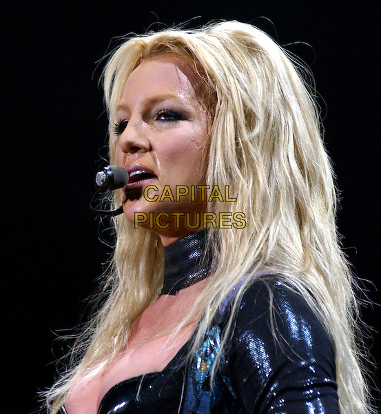 BRITNEY SPEARS.performs live for her opening show of Onyx Hotel Tour 2004 held at San Diego Sports Arena in San Diego, California .02 March 2004.*UK Sales Only*.music, gig, concert, singing, headshot, portrait, hair.www.capitalpictures.com.sales@capitalpictures.com.©Capital Pictures.