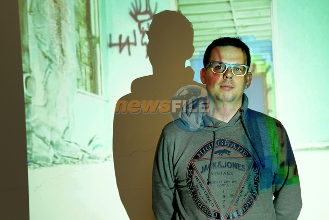 Shadow play – Declan Kelly of the Nexus Arts Group caught in the light of one of the installations at the Insight/Insounds audio visual group exhibition at Barlow House. Photo: Andy Spearman. www.newsfile.ie