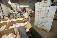 NWA Democrat-Gazette/ANTHONY REYES &bull; @NWATONYR<br /> Patsy Muller, with Northwest Rags, Inc., boxes rags Wednesday, Sept. 23, 2015 at their facility in Springdale. The comapny ships used clothing all over the world, and has a line of industrial rags, Ozark Recycled Wiping Rags.