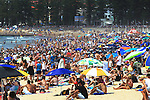 Sydney  crowds on a hot summers day at Manly Beach.  Sydney, Australia. January 16th  2013. Photo: (Steve Christo).