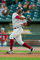 Victor Roache (28) of the Wisconsin Timber Rattlers follows through on his swing against the Great Lakes Loons at the Dow Diamond on May 4, 2013 in Midland, Michigan.  The Timber Rattlers defeated the Loons 6-4.  (Brian Westerholt/Four Seam Images)