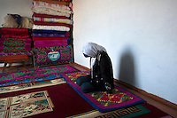 18 year old Aitilek sits in a room, her bowed head covered by a white scarf, the symbol that she has submitted to her kidnapper's demands of marriage. She was kidnapped by a man the day after they met in Bishkek. Although illegal, bride kidnapping is common in rural parts of Kyrgyzstan. Although illegal, bride kidnapping is common in rural parts of Kyrgyzstan. Each year around 16, 000 women become married after being kidnapped. They are known as 'Ala Kachuu' that translates as 'to grab and run away'. Defenders of the continuation of the practice sight tradition. However, during Soviet Times it was rare, and parents generally arranged marriages.