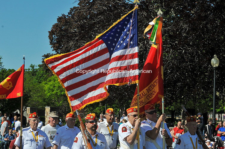 TORRINGTON, CT 27 MAY 2013--052713JS05- Members of the Marine Corps League fly the colors while marching in the annual Torrington Memorial Day parade on Monday. .Jim Shannon Republican American