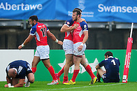 Charles Kingham of Great Britain is congratulated on his try. FISU World University Championship Rugby Sevens Men's Semi Final between Great Britain and France on July 9, 2016 at the Swansea University International Sports Village in Swansea, Wales. Photo by: Patrick Khachfe / Onside Images