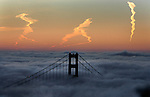 The Golden Gate Bridge was visual through the dense fog just before sunrise viewed from the Marin headlands in Sausalito, California.