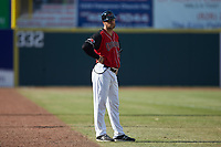 Hickory Crawdads manager Matt Hagan (39) coaches third base during the game against the Lakewood BlueClaws at L.P. Frans Stadium on April 28, 2019 in Hickory, North Carolina. The Crawdads defeated the BlueClaws 10-3. (Brian Westerholt/Four Seam Images)