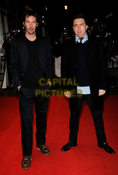"""KEANU REEVES & SASHA & GERVASI.The premiere of """"Anvil! The Story Of Anvil"""" during the Times BFI 52nd London Film Festival, at the Odeon West End, London, England, .October 21st, 2008.LFF full length grey gray scarf black navy suit black coat tie jumper brown shoes .CAP/CAN.©Can Nguyen/Capital Pictures."""
