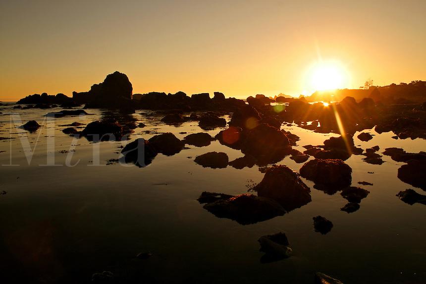 Sunset rocks low tide Crescent City California