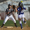 Toniann Servider #7, Clarke shortstop, left, takes a throw before tagging Jordyn Pasqueralli #18 of Division Avenue in the top of the fifth inning of a Nassau County Conference ABC-II varsity softball game at Clarke High School on Thursday, April 26, 2018. Clarke won by a score of 4-2.