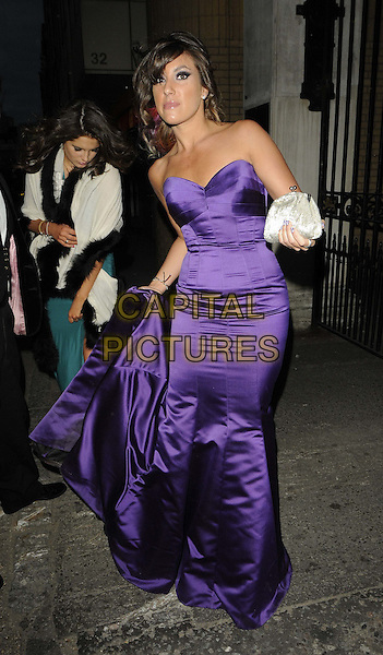 Gabriella Ellis.attended the Spring Ball 2012, The Honourable Artillery Company, Armoury House, City Rd., Moorgate, London, England, UK, 31st March 2012..full length strapless purple dress gown long maxi  silver bracelet cuff clutch bag corset fishtail silk satin holding train .CAP/CAN.©Can Nguyen/Capital Pictures.
