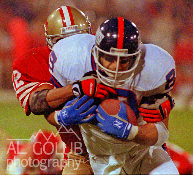 San Francisco 49ers vs New York Giants at Candlestick Park Monday, December 3, 1990..49ers beat Giants 7-3.49er defensive back Ronnie Lott (42) tackles Giants tight end Mark Bavaro (89)..