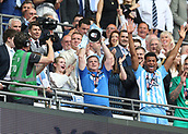 28th May 2018, Wembley Stadium, London, England;  EFL League 2 football, playoff final, Coventry City versus Exeter City; Coventry City manager Mark Robins lifts the EFL League 2 trophy alongside his players from the gantry