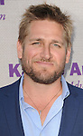 Curtis Stone attending the 14th Annual Chrysalis Butterfly Ball held at a private Mandeville Canyon Estate Los Angeles CA. June 6, 2015